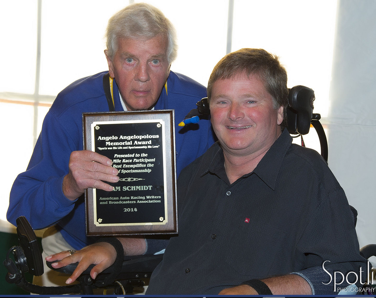 Dick Mittman presents Angelopolous Award to Sam Schmidt