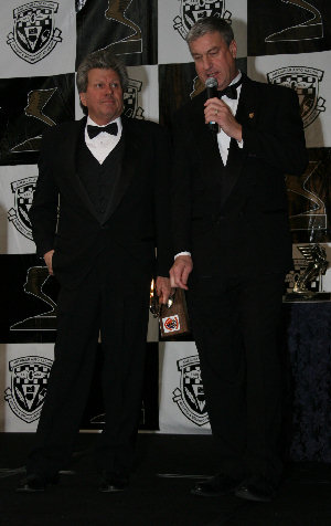 John Force with master of ceremonies Bob Jenkins - Ron McQueeney, IMS - click for high-resolution photo